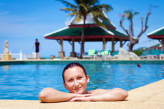 Beautiful young woman enjoying tropical holidays Stock Images