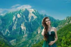 Beautiful young woman enjoying valley view nature over mountain Stock Photos