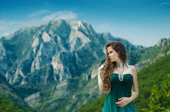 Beautiful young woman enjoying valley view nature over mountain Royalty Free Stock Image