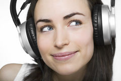 Beautiful young woman enjoys listening music Royalty Free Stock Photography