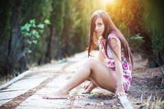 Beautiful young woman enjoys sun beams Royalty Free Stock Image