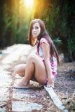 Beautiful young woman enjoys sun beams Royalty Free Stock Photography