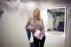 Beautiful young woman entrepreneur. Director of wedding salon Stock Photo