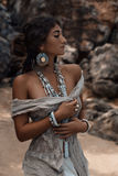 Beautiful young woman with ethnic accessories outdoors Royalty Free Stock Image