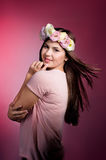 Beautiful young woman with eustoma flowers Stock Image