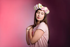 Beautiful young woman with eustoma flowers Stock Photography
