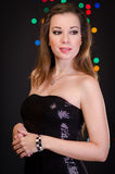 Beautiful young woman in evening dress Royalty Free Stock Photography