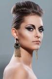 Beautiful young woman with evening makeup Stock Photos