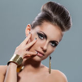 Beautiful young woman with evening makeup Stock Image