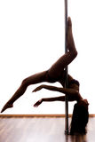 Beautiful young woman exercise pole dance Royalty Free Stock Photography