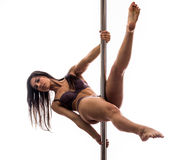 Beautiful young woman exercise pole dance Stock Images