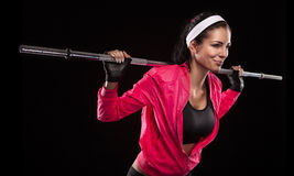 Beautiful young woman exercises with barbell dumbbell Isolated o stock photos