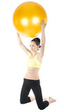 Beautiful young woman exercising with ball Royalty Free Stock Images