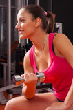 Beautiful young woman exercising with dumbbell Stock Photography