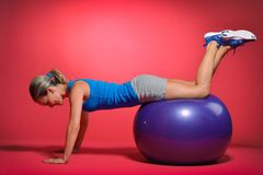 Beautiful young woman exercising Stock Images