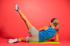 Beautiful young woman exercising Stock Photography