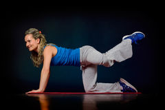 Beautiful young woman exercising Royalty Free Stock Photo