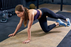 Beautiful Young Woman Exercising in Gym stock images