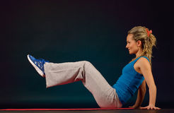 Beautiful young woman exercising in the gym Royalty Free Stock Image