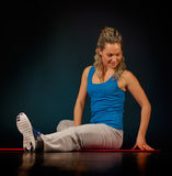 Beautiful young woman exercising in the gym Stock Image