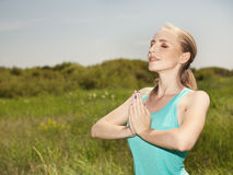 Beautiful  young  woman exercising in the outdoors yoga photo on Stock Images