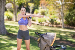 Beautiful young woman exercising. In park Stock Photo