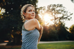 Beautiful young woman exercising in the park Stock Images