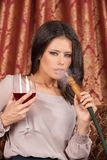 Beautiful young woman exhaling hookah. Royalty Free Stock Photos