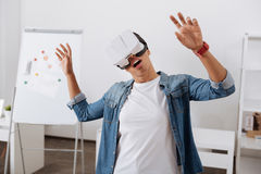 Beautiful young woman experiencing virtual reality. Different dimension. Beautiful good looking young woman wearing 3d glasses and experiencing virtual reality Royalty Free Stock Photos