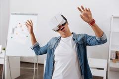 Beautiful young woman experiencing virtual reality Royalty Free Stock Photos