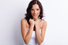 Beautiful young woman is expressing her strong royalty free stock image