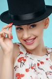Beautiful young woman with extravagant black cap Stock Image