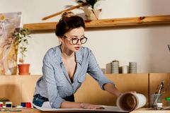 beautiful young woman in eyeglasses rolling canvas royalty free stock images