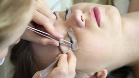 Beautiful young woman with eyelash extension. Woman eye with long eyelashes. Beautician eyelash extension for young