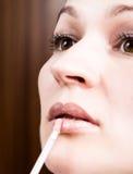 Beautiful young woman eyelash extension. Woman eye with long eyelashes. Beauty salon concept, lipstick lip gloss.  royalty free stock photos