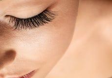 Beautiful young woman with eyelash extensions. Closeup stock photography