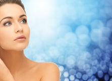 Beautiful young woman face and bare shoulder Royalty Free Stock Photo
