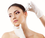 Beautiful young woman face with beauty treatment  isolated on wh Royalty Free Stock Image