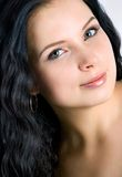 Beautiful young woman face. Black hair Royalty Free Stock Image
