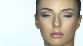 Beautiful young woman face close-up.