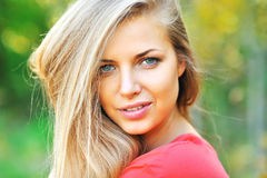 Beautiful young woman face closeup Stock Images