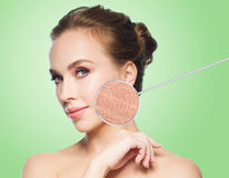 Beautiful young woman face with dry skin sample. Beauty, people and bodycare concept - beautiful young woman face with dry skin sample over green background Stock Photography