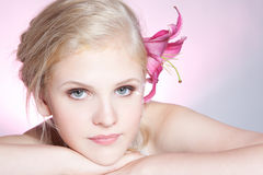 Beautiful young woman face with fresh flower Royalty Free Stock Images