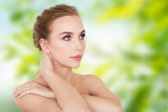 Beautiful young woman face and hands Royalty Free Stock Photos