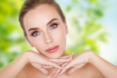 Beautiful young woman face and hands Royalty Free Stock Photography