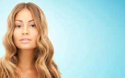 Beautiful young woman face with long hair Royalty Free Stock Images