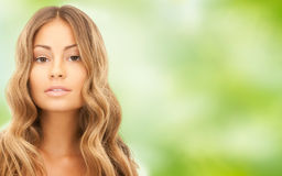 Beautiful young woman face with long hair Stock Photo
