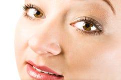 Beautiful young woman face with make up Stock Photos