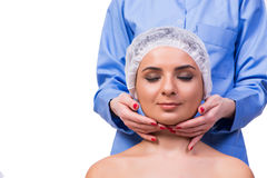 The beautiful young woman during face massage session Royalty Free Stock Images