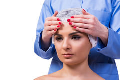 The beautiful young woman during face massage session Stock Image